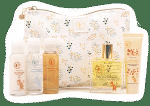 Trousse de voyage - trousse fleurie et ses produits - secrets de miel